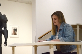 "Kelly Schoessling reads her story, ""Is it Distance or Space?"" (Photo credit: Emerson Davis)"